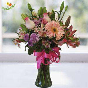 Jarron chico con flores rosadas