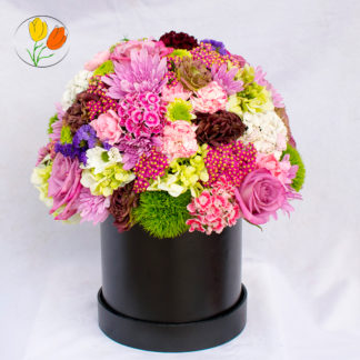 Primaveral en caja redonda